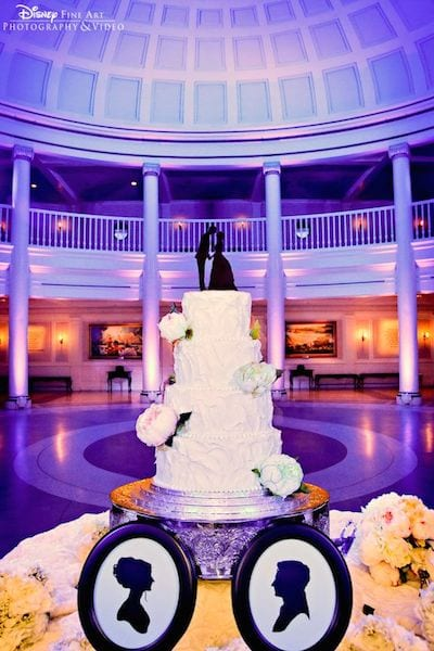 First off, the backdrop of the rotunda inside the American Adventure pavilion in EPCOT is beautiful. The cutout silhouettes on the cake and cake stand are classic and timeless.