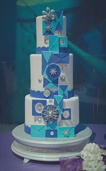 Mary Blair's signature style from it's a small world lends itself nicely to a wedding cake.