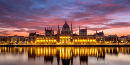 adventures-by-disney-europe-danube-river-cruise-itinerary-hero-02-budapest-parlament-building-illumination-cruise