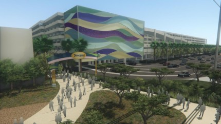 Disney intends to create a new transportation hub, parking structure and a pedestrian bridge over Harbor Boulevard connecting them with Disneyland and Disney California Adventure ahead of the opening of ÒStar WarsÓ land in its signature theme park. Above, a view from the south end of the parking structure off of Disney Way. (Rendering courtesy of  the Disneyland Resort)