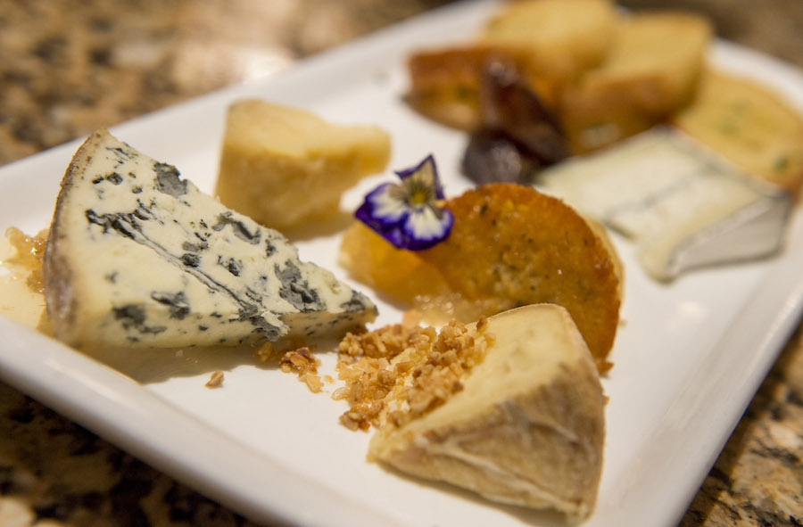 Artisan cheeses on a serving plate