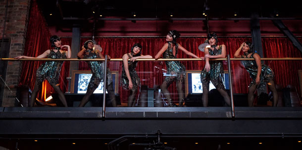 Flapper-style dancers at The Edison at Disney Springs