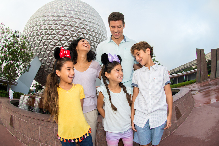Family in front of Spaceship Earth at Epcot