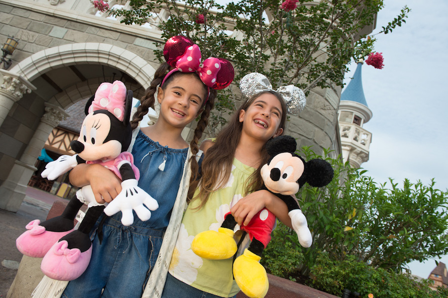 Girls with Mickey and Minnie Plushes at Magic Kingdom Park