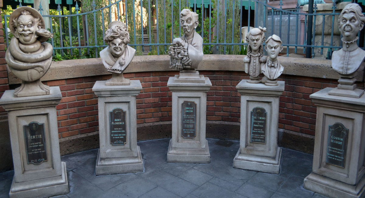 Family of busts in the cemetery at the Haunted Mansion