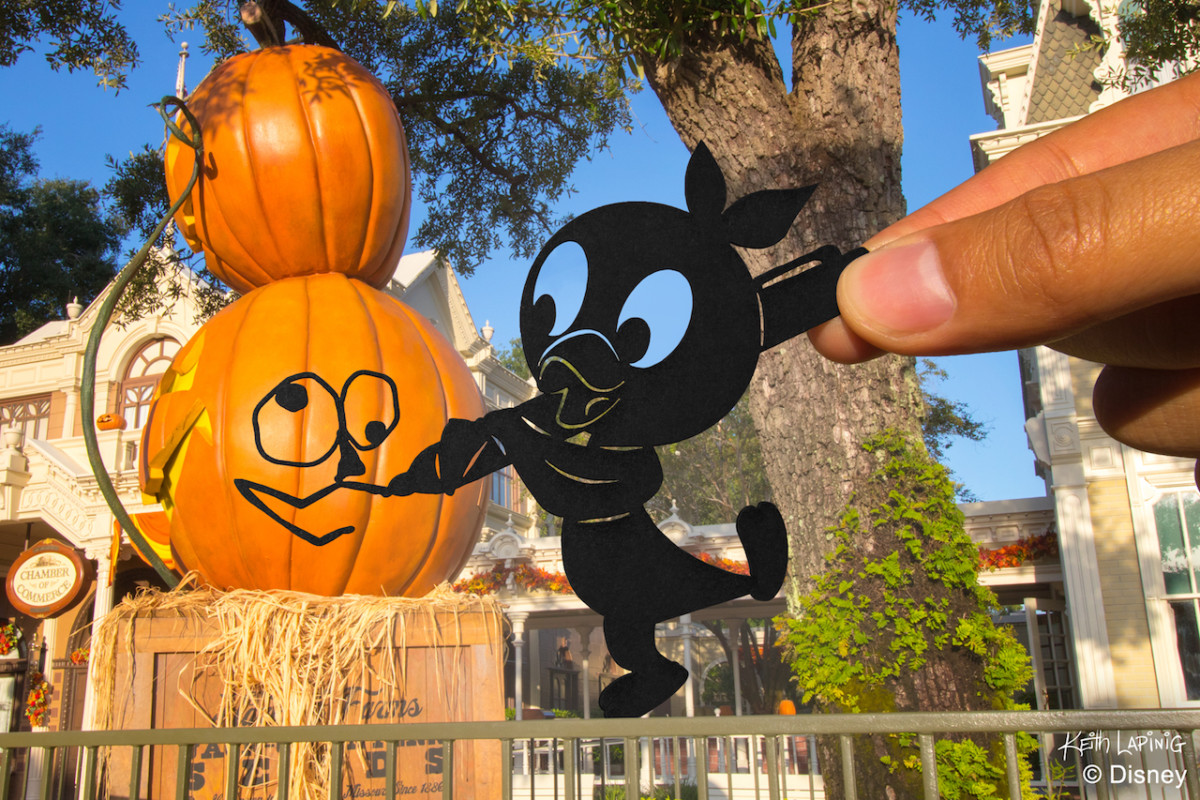 Orange Bird Silhouette helping with decorating Main Street for Halloween