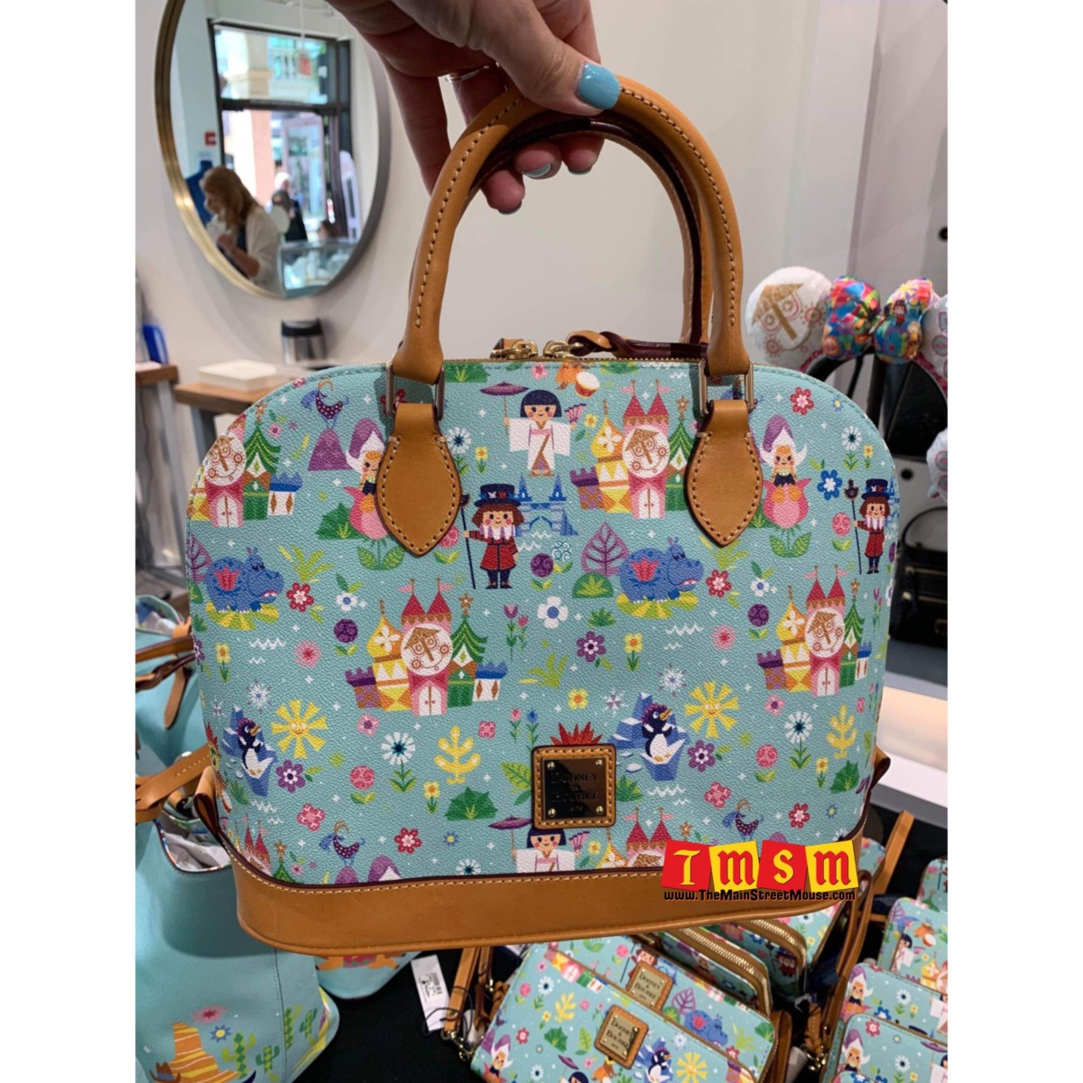 It's a small world after all with this new Dooney and Bourke collection 5