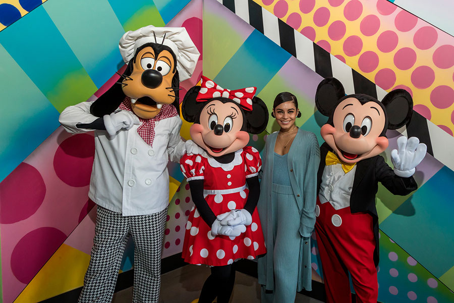 Goofy, Minnie, and Mickey pose with Vanessa Hudgens at Black Tap Craft Burgers & Shakes at the Downtown Disney District at the Disneyland Resort