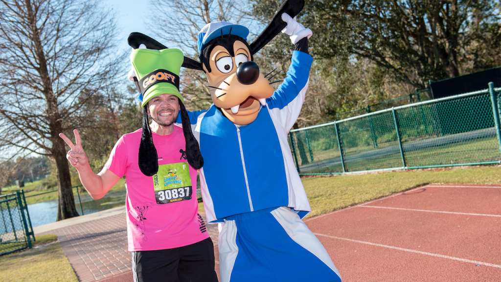 Guest with Goofy at a runDisney event