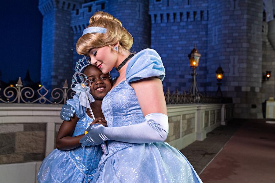 Guest with Cinderella at Magic Kingdom Park