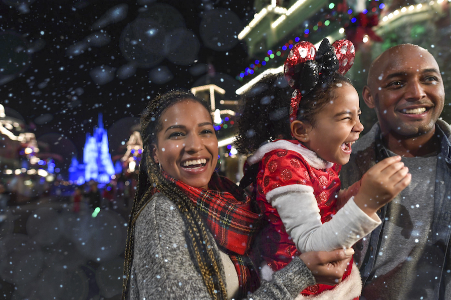 Family on Main Street U.S.A. during Mickey's Very Merry Christmas Party