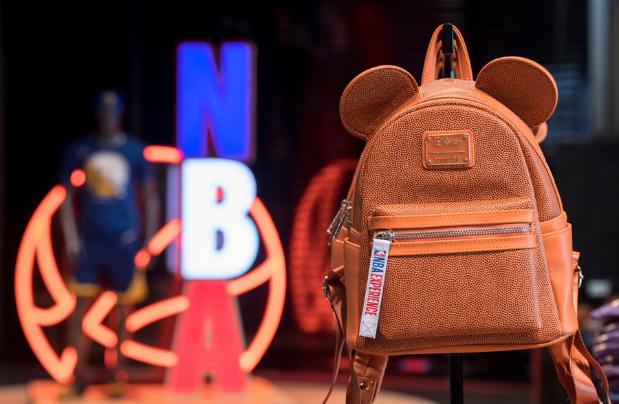 Loungefly mini-backpack featuring Mickey Mouse Ears and a pebble-grain design that mimics a basketball in the NBA Store inside NBA Experience at Disney Springs