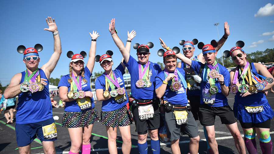 Runners display their runDisney medals