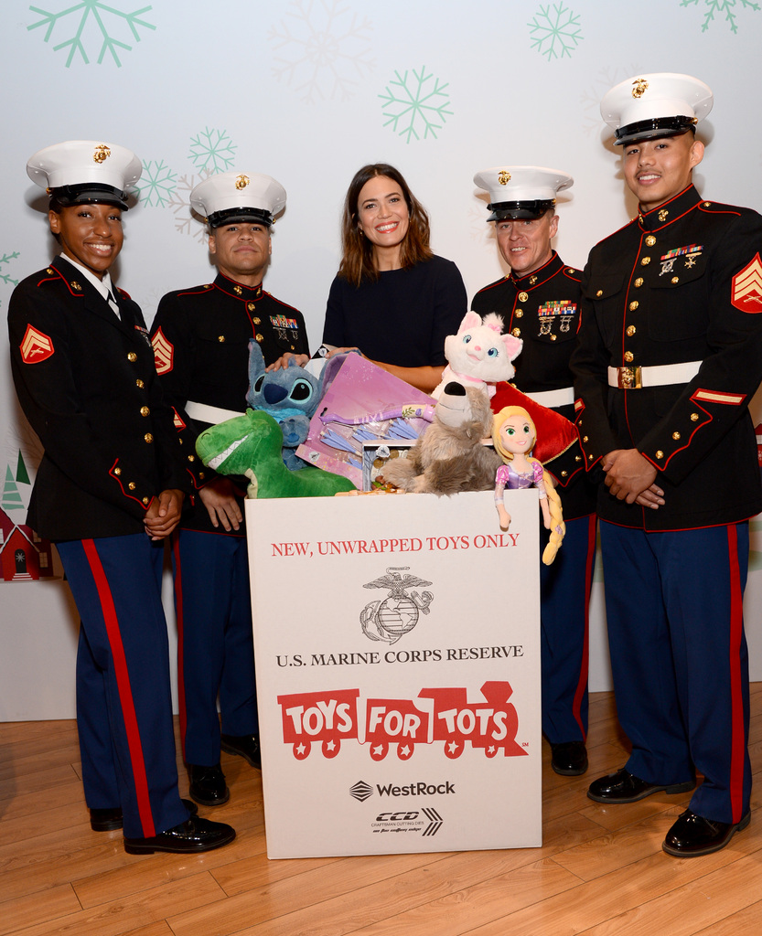 "Mandy Moore Reunites with Rapunzel at Disney store's ""Toy for Tots"" Toy Drive 9"